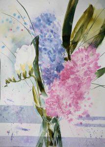 Freesie und Hyazinthen in Vase
